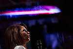 Republican presidential candidate Michele Bachmann addresses the Straw Poll in Ames, Iowa, August 13, 2011.