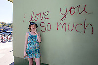 """An Austin local poses in front of the famous """"I love you so much"""" mural in South Congress, Austin, Texas - Stock Image."""