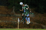 21 November 2013: USF's Terry Delancy (BAH) (18) and North Carolina's Boyd Okwuonu (behind). The University of North Carolina Tar Heels hosted the University of South Florida Bulls at Fetzer Field in Chapel Hill, NC in a 2013 NCAA Division I Men's Soccer Tournament First Round match. North Carolina won the game 1-0.