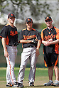 (L-R) Willie Eyre, Tsuyoshi Wada (Orioles), MARCH 9, 2012 - MLB : Baltimore Orioles' pitcher Tsuyoshi Wada with teammate Willie Eyre and interpreter Danny MacLeith during the Baltimore Orioles spring training camp at Ed Smith Stadium in Sarasota, Florida, United States. (Photo by Thomas Anderson/AFLO) (JAPANESE NEWSPAPER OUT)