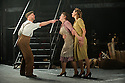 """London, UK. 16/09/2011. """"Street Scene"""" by Kurt Weill (music) and Elmer Rice (book) returns to The Young Vic, London. 24 hours in the life of a 1940's New York City tenement on a hot summer's day with an eighty-strong cast, full choir and orchestra. L to R: Geof Dolton (as Frank Maurrant), Elena Ferrari (as Mrs Maurrant) and Susanna Hurrel (as Rose Maurrant). Photo credit: Jane Hobson"""