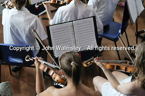 Rehearsal for the school orchestra before an evening performance for parents, state Secondary School.