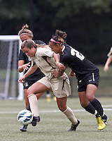Boston College forward Stephanie McCaffrey (9) and University of Central Florida midfielder/defender Sokhara Goodall (27) battle for the ball at midfield. After two overtime periods, Boston College tied University of Central Florida, 2-2, at Newton Campus Field, September 9, 2012.