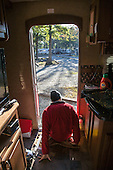 Glenn Fretz pushing himself out of the RV in the morning getting ready for the day's ride.