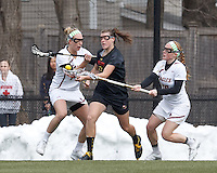 Boston College midfielder Mikaela Rix (17) and Boston College defender Kara O'Connell (10) team up on University of Maryland midfielder Kelly McPartland (6)..University of Maryland (black) defeated Boston College (white), 13-5, on the Newton Campus Lacrosse Field at Boston College, on March 16, 2013.