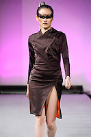 Tuyt Lan, Vietnam's Next Top Model 2010, walks the runway in an outfit from the Edwing D'Angelo Fall 2012 Beauty Attack collection, during Couture Fashion Week New York, February 19, 2012.
