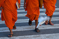 Monks and Dove Phnom Penh River side, Cambodia