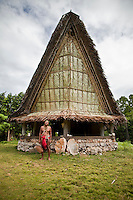 Local village chief outside a traditional men's house in Yap. Men and women sometimes gather in their own separate communal housing during the day. The traditional house is a key instrument to the passing of skills and culture from one generation to another. The men and young boys gather here and fishing and building skills are learned and discussed, Yap Micronesia. (Photo by Matt Considine - Images of Asia Collection)
