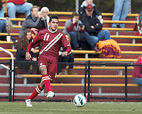 Boston College forward/midfielder Diego Medina-Mendez (11) passes the ball. Boston College (maroon) defeated Virginia Tech (Virginia Polytechnic Institute and State University) (white), 3-1, at Newton Campus Field, on November 3, 2013.