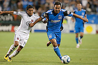 Arturo Alvarez (right) dribbles against Andy Najar (14). The San Jose Earthquakes tied DC United 1-1 at Buck Shaw Stadium in Santa Clara, California on July 3rd, 2010.
