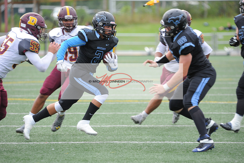 Chugiak's Anthony Jones runs the ball  as teammate Alex Rumfelt provides support. Photo by Michael Dinneen for the Star.