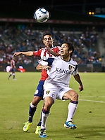 CARSON, CA – August 27, 2011: Chivas USA defender Mariano Trujillo (8) and Real Salt Lake defender Tony Beltran (2) during the match between Chivas USA and Real Salt Lake at the Home Depot Center in Carson, California. Final score Chivas USA 0, Real Salt Lake 1.