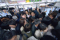 Inside a train on Tokyo's Yamanote circle line. Tokyo has one of the most extensive and efficient transport networks in the world - but also one of the most crowded. Rail companies calculate crowding by percent of standard capacity (ie when all the seats and standing spaces are occupied). Some trains reach 220%+.