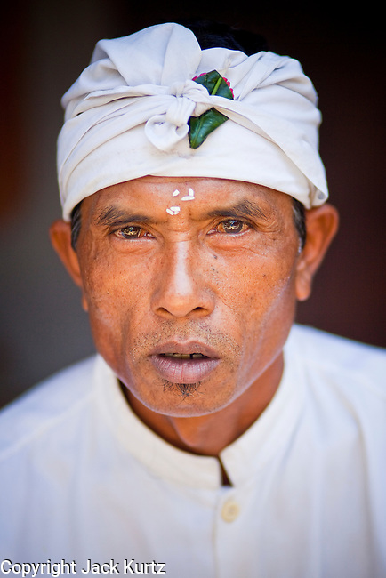 Apr. 22 - UBUD, BALI, INDONESIA:   A priest at an Odalan ceremony in a family temple in Ubud, Bali, Indonesia. The Odalan ceremony is the &quot;birthday&quot; ceremony for Hindu temples in Bali and are held every 210 days. They are common in Bali.   Photo by Jack Kurtz/ZUMA Press.
