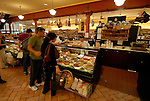 DiBruno Brothers cheese and gourmet food shop.  Shoppers at store..Philadelphia, Pennsylvania, PA USA.  Photo copyright Lee Foster, 510-549-2202, lee@fostertravel.com, www.fostertravel.com. Photo 321-30673