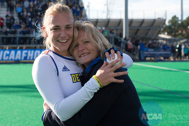 NORFOLK, VA - NOVEMBER 20:  Greta Nauck (21) of the University of Delaware and her mother Helga Nauck celebrate their victory over the University of North Carolina during the Division I Women's Field Hockey Championship held at the LR Hill Sports Complex on November 20, 2016 in Norfolk, Virginia.  Delaware defeated North Carolina 3-2 for the national title. (Photo by Jamie Schwaberow/NCAA Photos via Getty Images)