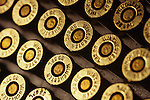 Winchester rifle cartridges, 38 special, full metal jacket, rows of bullets, selective focus, warm light.
