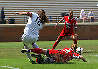 WINSTON-SALEM, NORTH CAROLINA - September 01, 2013:<br /> Chelsea Hunter (10) of Louisville University gets the ball away from Katie Stengel (12) of Wake Forest University during a match at the Wake Forest Invitational tournament at Wake Forest University on September 01. The match was abandoned early in the second half due to severe weather with Wake leading 1-0.