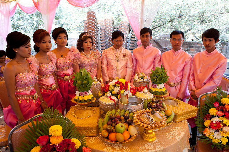 The wedding party lines up during a Buddhist wedding ceremony  in a small village outside of Phnom Penh, Cambodia. <br /> <br /> Photos &copy; Dennis Drenner 2013.