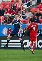 22 May 2010: New England Revolution defender Zak Boggs #33 and Toronto FC defender Dan Gargan #8 in action during a game between the New England Revolution and Toronto FC at BMO Field in Toronto..Toronto FC won 1-0.....