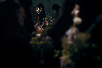 Christian Orthodox nuns holding candles and flowers walk on August 25, 2013 along the narrow streets of Jerusalem's Old City in a religious procession marking the Dormition of the Theotokos (God-bearer) which commemorates the Virgin Mary. Thousands of Christian Orthodox clergy and pilgrims took part in the early morning procession, an annual event during which Orthodox believers carry an icon of the Virgin Mary from the Church of the Holy Sepulchre to Mary's Tomb Church, located on the foothills of the Mount of Olives, near Gethsemane garden, which is regarded as the burial place of Virgin, according to Christian tradition. Photo by Oren Nahshon
