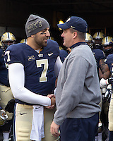 Pitt quarterback Tom Savage (7) shakes hands with Pitt head coach Paul Chryst on senior day. The Miami Hurricanes defeated the Pitt Panthers 41-31 at Heinz Field, Pittsburgh, Pennsylvania on November 29, 2013.