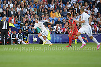 Cardiff City Stadium, Cardiff, South Wales - Tuesday 12th Aug 2014 - UEFA Super Cup Final - Real Madrid v Sevilla - <br /> <br /> Real Madrid&rsquo;s Gareth Bale sets up another attack during the game. <br /> <br /> <br /> <br /> Photo by Jeff Thomas/Jeff Thomas Photography