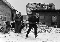 Bosnian government fighters run under fire on Sarajevo's front line on December 2, 1992.