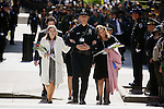 Sarah Hanson, left, daughter of slain Sgt. Scott Hanson, walks with her mother, Allison Hanson and Sgt. John Curler of the Covinia Police Department, as they arrive with other family members of last years officers who were killed in the line of duty, at the 2007 California Peace Officers Memorial ceremony next to the State Capitol, Thursday May 3, 2007. Sgt. Scott Hanson was killed in the line of duty, July 3, 2006..Sacramento Bee/ Brian Baer.Curley (cq) Pat Buchanan 626-858-4404