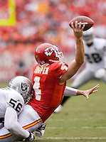 KANSAS CITY, MO - SEPTEMBER 14:   Tyler Thigpen #4 of the Kansas City Chiefs is tackled by Derrick Burgess #56 of the Oakland Raiders at Arrowhead Stadium on September 14, 2008 in Kansas City, Missouri.  The Raiders defeated the Chiefs 23-8.  (Photo by Wesley Hitt/Getty Images) *** Local Caption *** Tyler Thigpen; Derrick Burgess