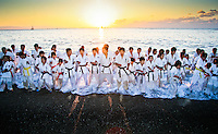 New Years day sunrise on Katsurahama beach in Kochi  sees the local Karate club run into the sea to carry out their warm up exercises.