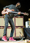Incubus bassist Ben Kenney performs during the band's set at the KROQ Weenie Roast y Fiesta at Verizon Wireless Amphitheater Saturday.