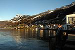 Beckonried on the lake Stätten See with the elevatedmotorway above the town. Beckonried, Luzern, Switzerland.