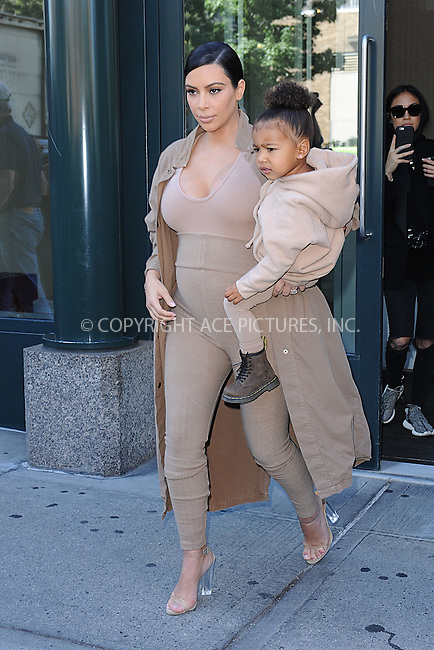 WWW.ACEPIXS.COM<br /> September 16, 2015 New York City<br />  <br /> Kim Kardashian and North West leave apartment  to attend Kanye West Fashion Show on September 16, 2015 in New York City<br /> <br /> Credit: Kristin Callahan/ACE<br />  <br /> Tel: 646 769 0430<br /> Email: info@acepixs.com<br /> www.acepixs.com