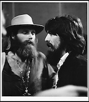 BNPS.co.uk (01202 558833).Pic: FameBureau/BNPS..Rock Gods - George Harrison meets Beach Boy Mike Love...Get me Wonga.....A 'lost' archive of original music manuscripts, contracts and pictures of the Beach Boys has emerged for sale for nearly seven million pounds...The vast collection, that spans the first 20 years of the band's hugely successful career and consists of thousands of documents, was found forgotten in a storage unit...The treasure trove includes the sheet music for the Beach Boys' classic hits like 'God Only Knows', 'Good Vibrations' and 'Fun, Fun, Fun.'..It also includes handwritten lyrucs, recording contracts and copyright certificates signed by Brian Wilson and Mike Love, musical arrangements, royalty cheques and personal letters...And there are more than 60 behind-the-scenes photos of the hugely successful American rock band, many of them never seen before..