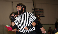 Front pack referee Al Capwn3d yells to the skaters.