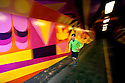 PE00277-00...WASHINGTON - Piierce Prohovost jogging in a pedestrian tunnel on the Burk Gilman Trail in Kenmore. (MR# P9)