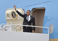 United States President Barack Obama waves as he boards Air Force One at Joint Base Andrews, Maryland to fly to Jerusalem to head the US delegation at the funeral of former President Shimon Peres of Israel on Thursday, September 29, 2016.<br /> Credit: Ron Sachs / Pool via CNP /MediaPunch
