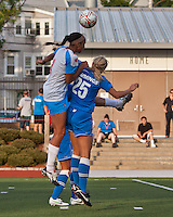 Chicago Red Stars defender/forward Ashlee Elliott (2) and Boston Breakers defender Taryn Hemmings (25) compete for a head ball.  The Boston Breakers beat the Chicago Red Stars 1-0 at Dilboy Stadium.