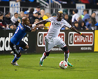 Santa Clara, California -Saturday, March 29, 2014: Jordan Stewart of SJ Earthquakes tries to slow down Saer Sene of NE Revolution during a match at Buck Shaw Stadium. Final Score: SJ Earthquakes 1, NE Revolution 2