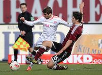 FUSSBALL   1. BUNDESLIGA  SAISON 2012/2013   12. Spieltag 1. FC Nuernberg - FC Bayern Muenchen      17.11.2012 Thomas Mueller (li, FC Bayern Muenchen) gegen Timm Klose (1 FC Nuernberg)