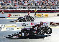 May 4, 2012; Commerce, GA, USA: NHRA pro stock motorcycle rider Andrew Hines (near lane) races alongside teammate Eddie Krawiec during qualifying for the Southern Nationals at Atlanta Dragway. Mandatory Credit: Mark J. Rebilas-