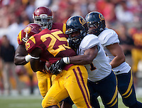 September 22, 2012: California's DeAndre Coleman tackles USC's Silas Redo during a game at the Los Angeles Memorial Coliseum, Los Angeles, Ca  USC defeated California 27- 9