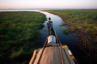 Boatman Atraman Maika watches the channel of the river from atop a pinasse on the Niger River, Jan. 5, 2008.