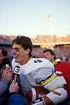 Michigan Wolverines quarterback Jim Harbaugh celebrates a 26-24 victory over the Ohio State Buckeyes at Ohio Stadium in Columbus, Ohio on 11/22/86. Photo by John D. Hanlon, 25-year photographer for Sports Illustrated.
