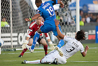 Ryan Johnson (19) shoots against Troy Perkins, defended by Juan Manuel Pena (3). The San Jose Earthquakes tied DC United 1-1 at Buck Shaw Stadium in Santa Clara, California on July 3rd, 2010.