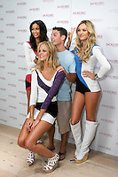 Chanel Iman, Erin Heatherton, and  Candice Swanepoel pose with guest during the &quot;Incredible by Victoria's Secret&quot; launch at the Victoria Secret SOHO Store, August 10, 2010.