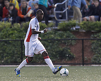 New England Revolution midfielder Kalifa Cisse (4) looks to pass. 2013 Lamar Hunt U.S Open Cup fourth round, New England Revolution (white) defeated New York Red Bulls (blue/yellow), 4-2, at Harvard University's Soldiers Field Soccer Stadium on June 12, 2013.