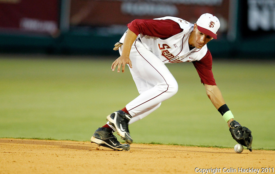 TALLAHASSEE, FL 5/20/11-FSU-CLEMBASE11 CH-Florida State's Justin Gonzalez can't get his glove under a ground and earns an error during the Clemson game Friday at Dick Howser Stadium in Tallahassee. The Seminoles lost to the Tigers 4-7..COLIN HACKLEY PHOTO