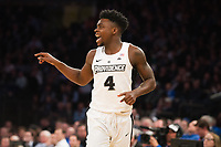 NEW YORK, NY - Thursday March 9, 2017: Maliek White (#4) of Providence calls out to a teammate as his friars take on Creighton in the Quarterfinals of the Big East Tournament at Madison Square Garden.